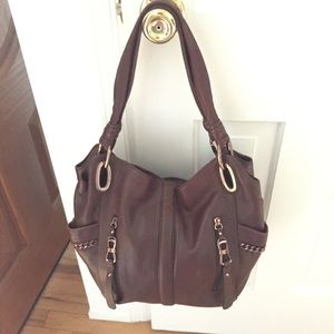 Beautiful brown leather bag with rose gold trim